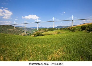 MILLAU, FRANCE - JULY 12, 2013: View of the Millau Viaduct, the tallest cable-stayed bridge over the Tarn valley in France, designed by the structural engineer Virlogeux and architect Foster.