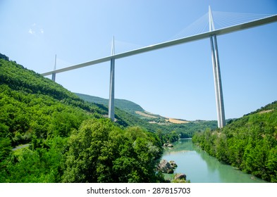 MILLAU, FRANCE - JULY 25: The Millau Viaduct in France. The bridge is the tallest in the world with one mast's summit at 343 meters. July 25, 2013 in Millau, France