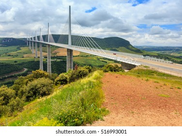 MILLAU, FRANCE -  JUNE 03, 2016: Cable-stayed bridge Millau Viaduct over summer valley River Tarn.