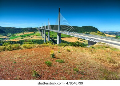 MILLAU,FRANCE - JULY 03, 2016: Best locations of world,spectacular viaduct of Millau with agriculture fields,Aveyron region,France,Europe JULY 03, 2016 in Millau,France
