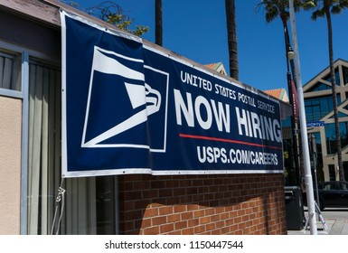 Millbrae,CA 8/5/2018: USPS,United States Post al Office recruits by Now Hiring sign on the wall