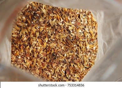 Milled malted barley(grist) inside a plastic packet which will be used to make craft beer.
