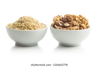 Milled and whole walnuts kernels in bowl isolated on white background.