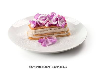 Millefeuille of meringue biscuit with almonds and rose petals