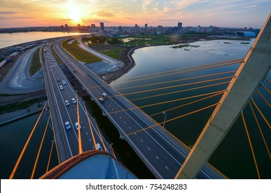 Millenium bridge in Kazan aerial view at sunset time with panoramic view of Kazan city. On the top of Millenium bridge in Kazan, Russia