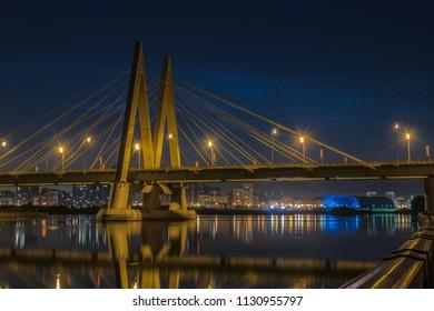 Millenium bridge in Kazan, reflected in the waters of the river Kazanka. Russia