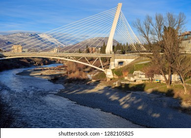 Millenium bridge on river Moraca (Morača) in Podgorica, capital of Montenegro, on a winter day, illuminated by setting sun.