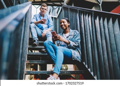 Millennial bloggers sharing web information during smartphone networking for communicate with web followers, multiracial male and female friends ignoring each other prefer mobile addiction