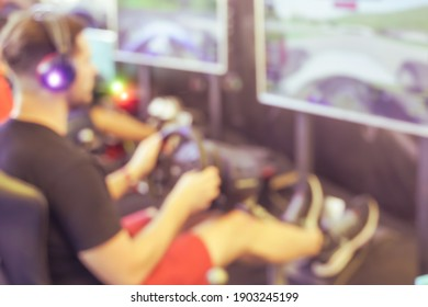 Millennial boy playing with new videogame. The greatest gaming tournaments in the world.  Defocused picture.
