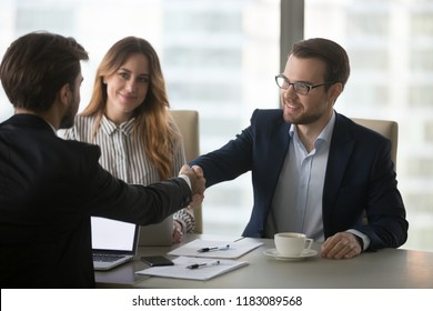 Millennial business partners shaking hands greeting ready to negotiate, company CEO handshaking colleague after successful meeting or negotiations in office. Concept of partnership, cooperation