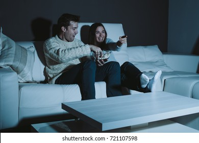 Millennial couple watching TV late at night