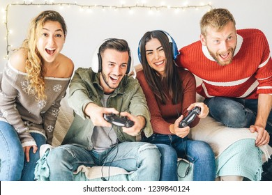 Millennial friends playing video games online with headset - Young people having fun with new trends technologies - Gaming, entertainment, fun, tech and youth lifestyle holidays