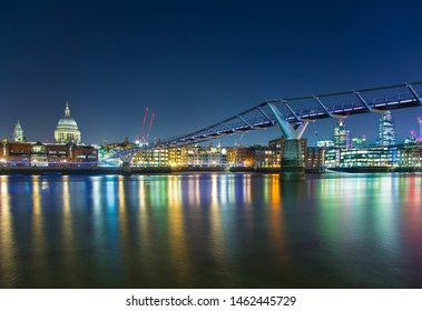 Millennium Bridge Elegant steel suspension footbridge crossing the Thames from the Tate Modern to St Paul's Cathedral Thames River London England
