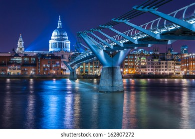 Millennium Bridge leading to Saint Paul's Cathedral in central London, UK. Aged photo.