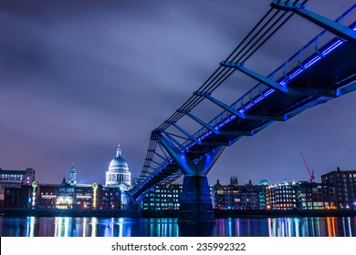 Millennium Bridge leads to Saint Paul's Cathedral in central London at night, cross processing