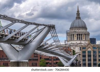 Millennium bridge London with cloudy sky background