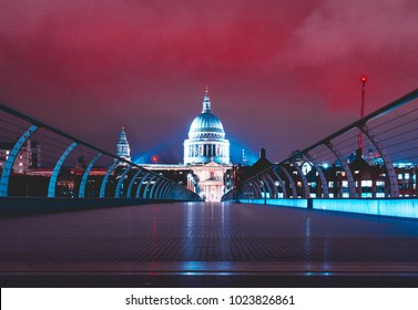 Millennium Bridge at night with st pauls at the end with colorful red night sky