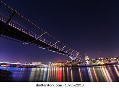 Millennium Bridge at night Thames River famous footbridge City of London England