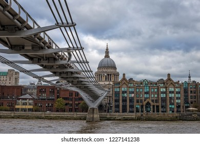 Millennium Bridge over river Thames with St. Paul's Cathedral, London, UK