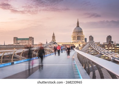 The Millennium Bridge to the St Paul's Cathedral in Twilight with Moving People