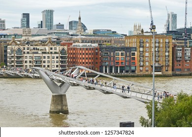 THE MILLENNIUM BRIDGE, THAMES EMBANKMENT, LONDON. AUGUST 2018. The Millennium Footbridge a suspension bridge over the River Thames with the skyline of the City of London from the Tate Modern.