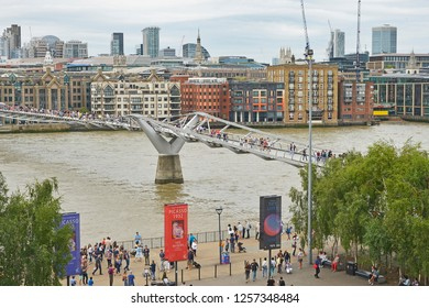 THE MILLENNIUM BRIDGE, THAMES EMBANKMENT, LONDON. AUGUST 2018. The Millennium Footbridge asuspension bridge over the River Thames with the skyline of the City of London from the Tate Modern.