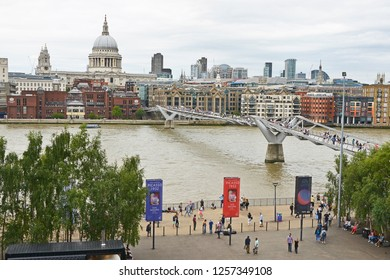THE MILLENNIUM BRIDGE, THAMES EMBANKMENT, LONDON. AUGUST 2018. The Millennium Footbridge a suspension bridge over the River Thames with St Pauls and the skyline of the City of London from the Tate