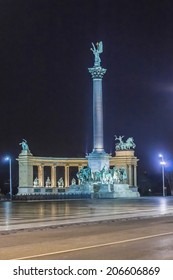 Millennium Monument at night - major attraction of city, with 36 m high Corinthian column in center. Heroes' Square, Budapest, Hungary.