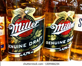 miller beer logo closeup on beer bottles on a supermarket shelf in Kiev, Ukraine, 8 February 2019.