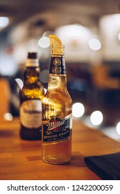 Miller beer standing on the table.