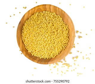 millet isolated in a wooden bowl