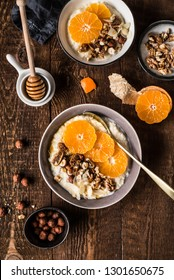 Millet with mandarins, walnut, figs and honey. Wooden background.