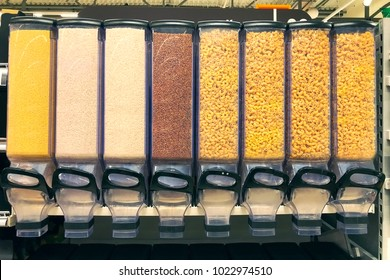 millet, rice, buckwheat, pasta in the containers dispensers