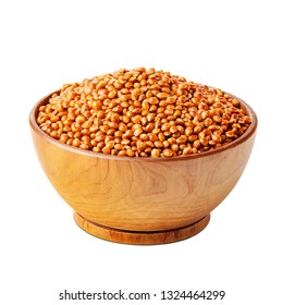 Millet with shells in a wooden bowl isolated on white