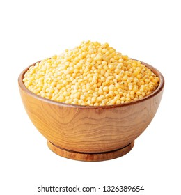 Millet in a wooden bowl isolated on white