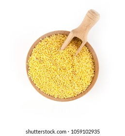 Millet in a wooden bowl with a scoop   isolated on a white background.
