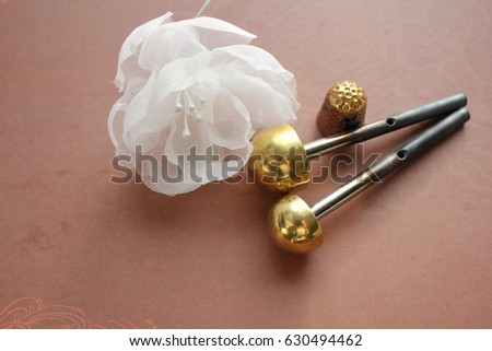 Millinery hat making tools silk flowers stock photo edit now millinery and hat making tools silk flowers and thimble mightylinksfo