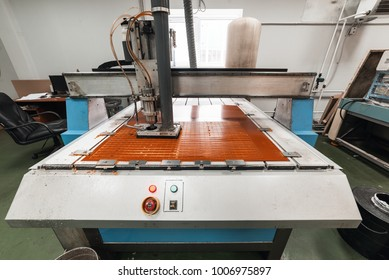 Milling engraving machine. The machine cuts blanks for electronic printed circuit boards.