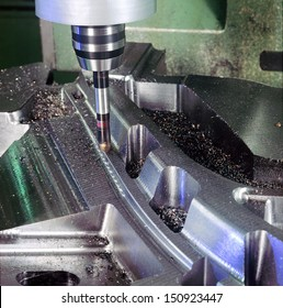 A milling machine working on steel particular