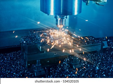 Milling machine working on steel detail with lot of sparks
