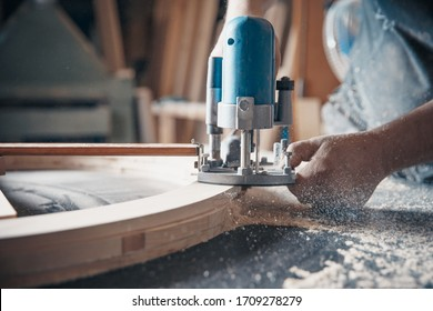 Milling wood in the joinery using manual mechanical cutters.
