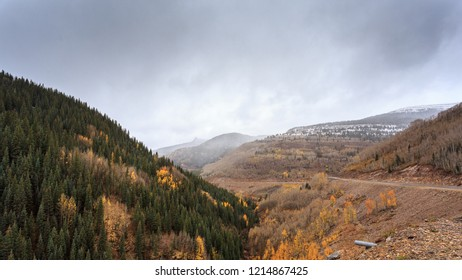 Million dollar highway through southwest Colorado in fall colors and ominous clouds