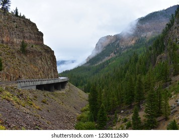 The million dollar road. When this road was built decades ago it costed over a million dollars to build. This bridge runs through the mountains and connects part of Yellowstone together.