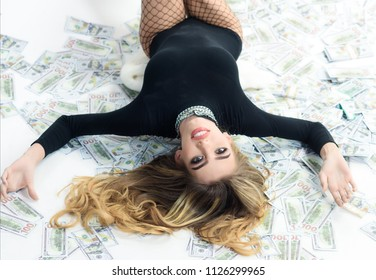 Millionaire, billionaire, wealthy sensual woman with many banknote. Rich woman. Businesswoman in black costume lying in banknotes. Bank concept. Saving money concept. Business concept. Erotic lingerie