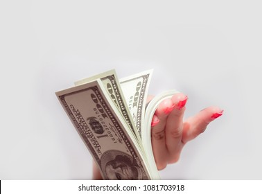 Millionaire lifestyle Over rich Concept . Elegant Gorgeous lady enjoy Kiss and counting money US $100 dollar bill banknotes Happy bonus at home . Independent Business