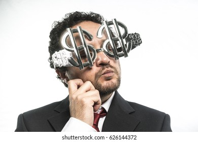 Millionare, Businessman with suit and glasses in the form of dollars. Expressions of stress, overwhelm and craving for money