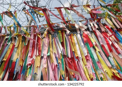 Millions of prayer ribbons. Millions of prayer ribbons tied to the fence wishing peace and unification for North and South Korea. Taken in Demilitarised Zone (DMZ) in South Korea