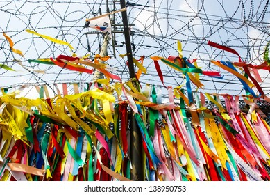Millions of prayer ribbons tied to the fence wishing peace and unification for North and South Korea. Taken in Demilitarised Zone (DMZ) in South Korea