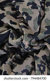 Millitary fabric closeup cloth photo. Millitary pattern green black texture. Photo.