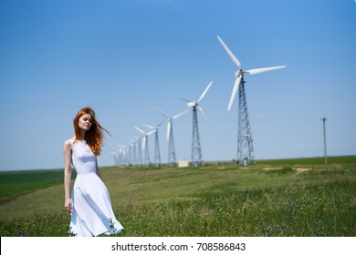 mills, field, turbines, woman in white dress in nature, silence, sunny day, summer